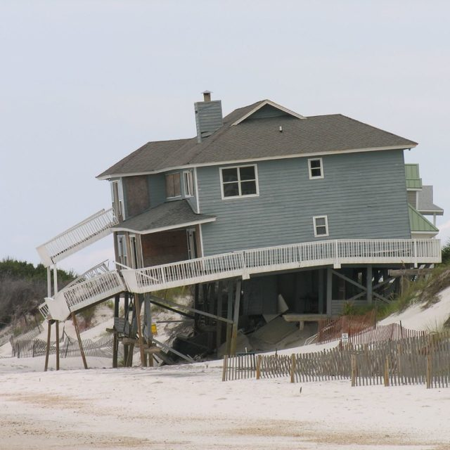 Large house built directly on sand, now collapsing