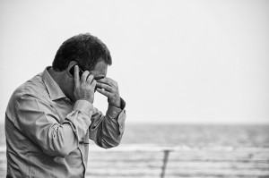 Worried man talking on a cellphone