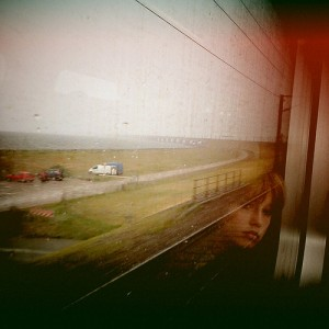 Woman looking out a train window by BjArn Giesenbauer on Flickr