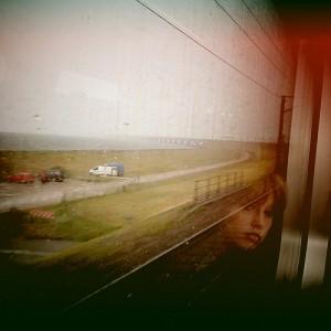 Woman looking out a train window by BjArn Giesenbauer on Flickr