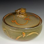 Ceramic casserole with a shino glaze by Marcia Halperin