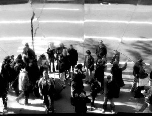 A crowd of people reflected in a mirror