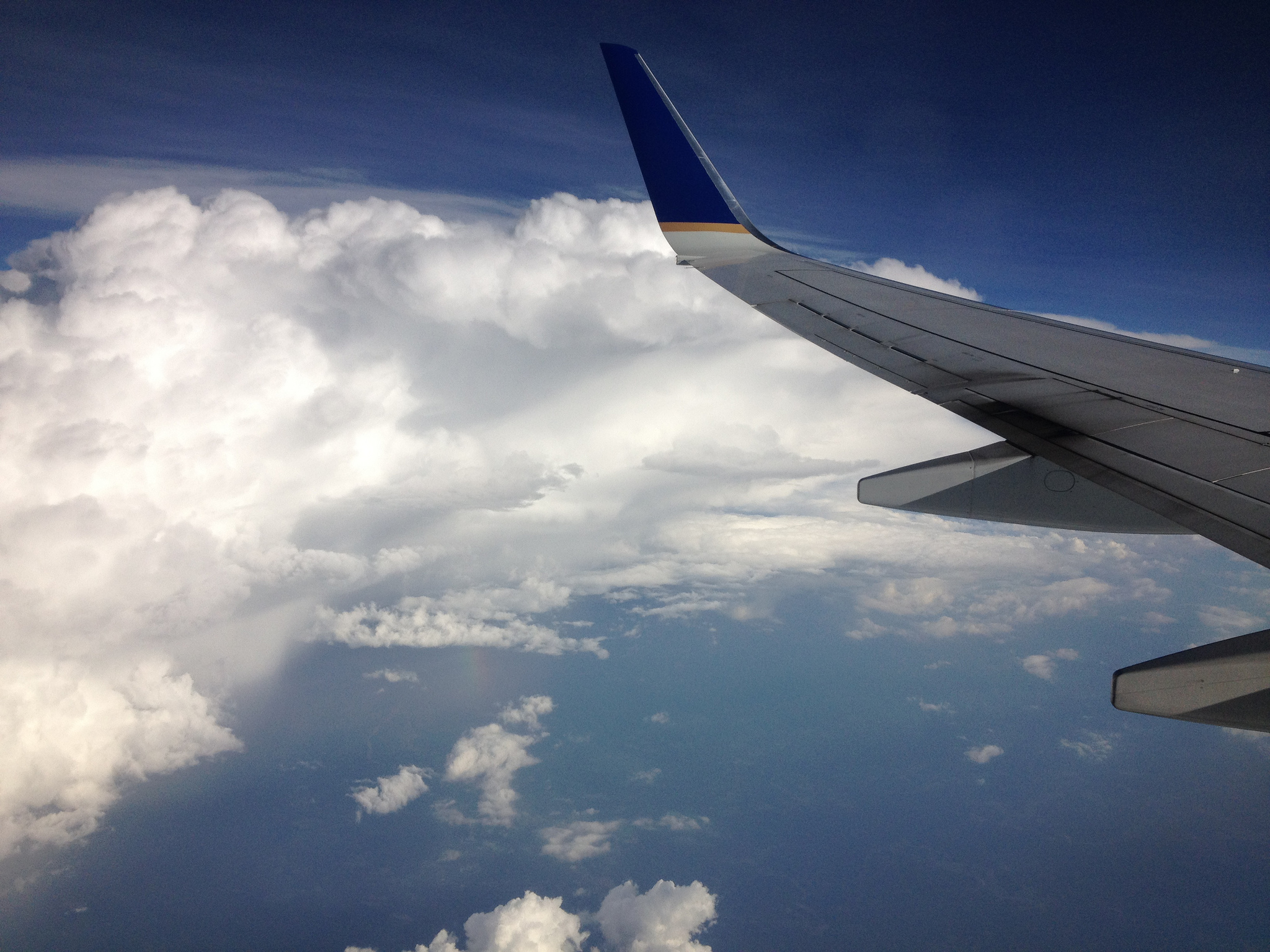 View of clouds and an airplane wing