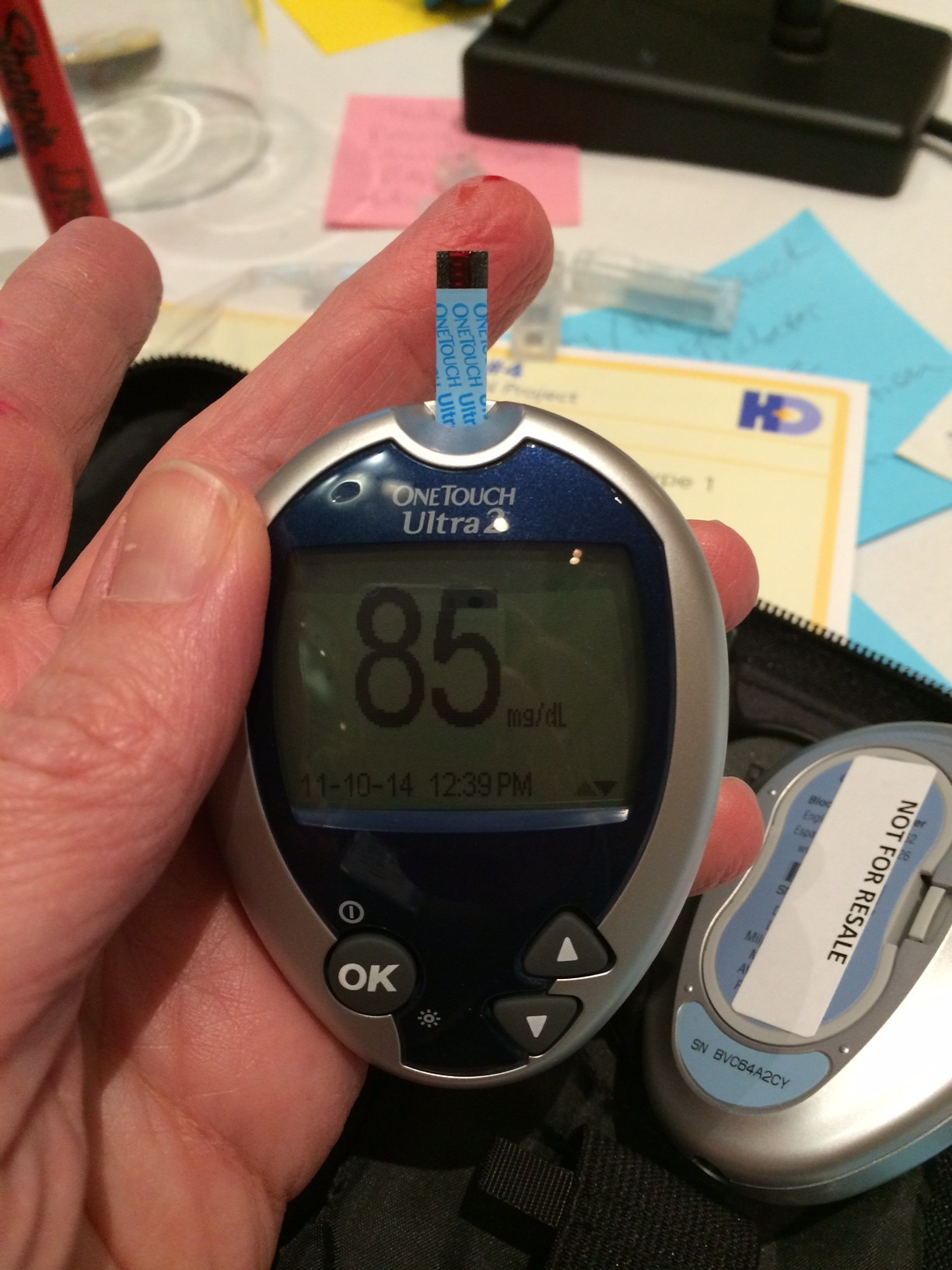Glucose meter displaying the number 85