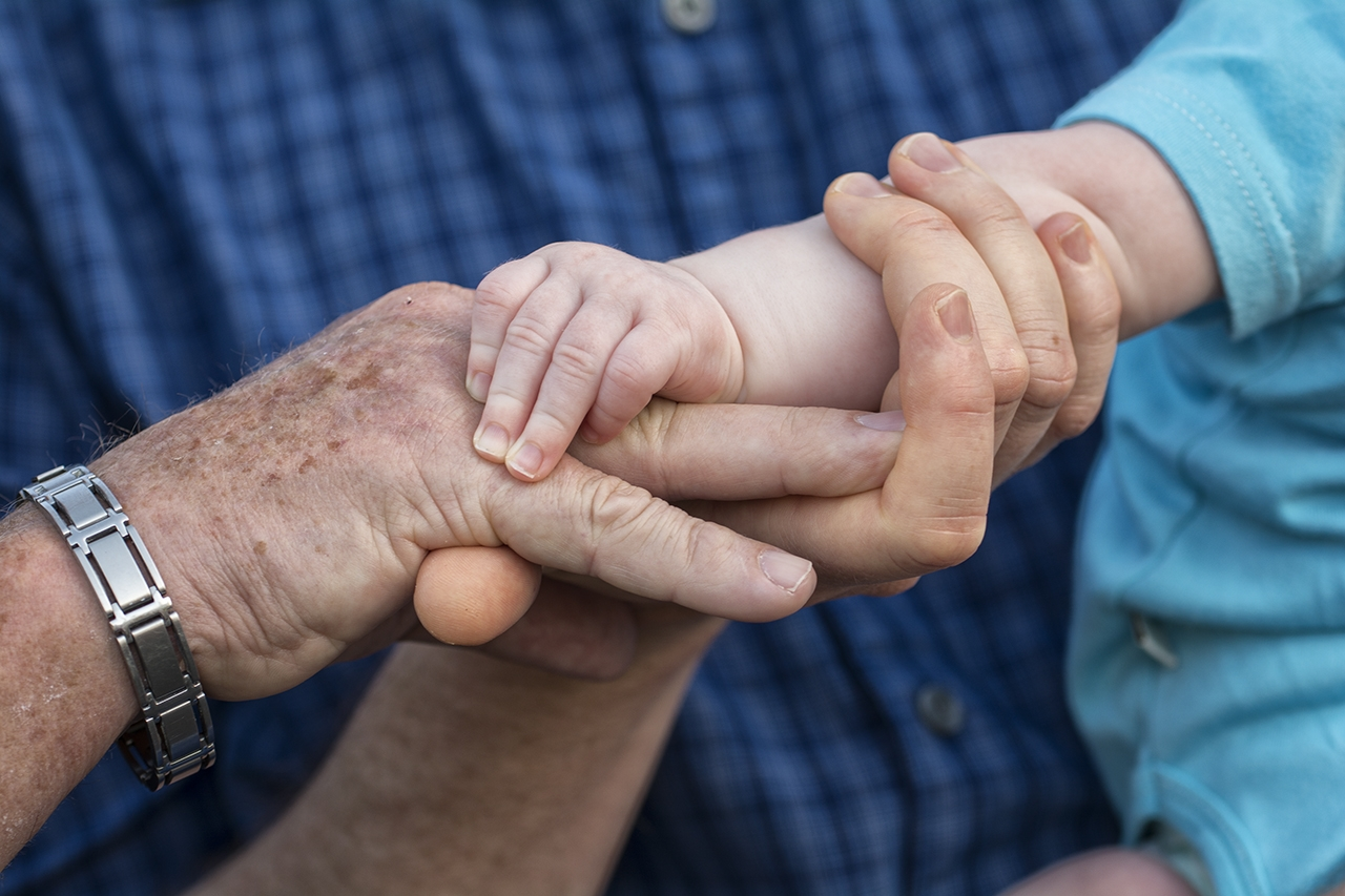 Three generations of hands