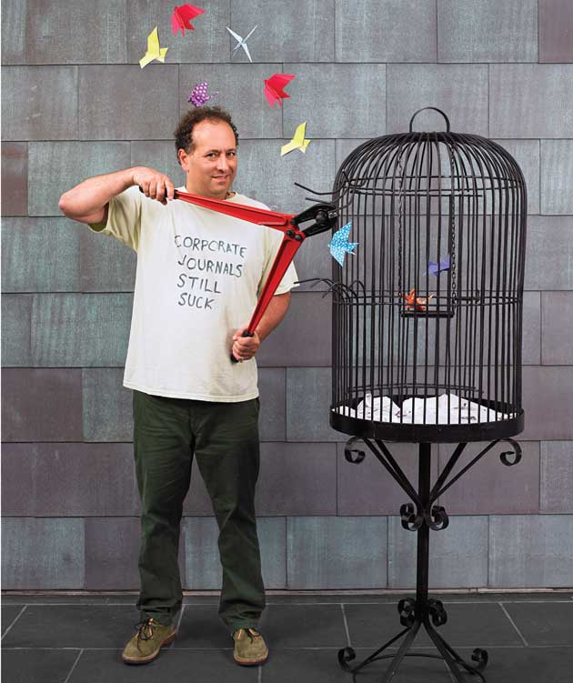Michael Eisen cutting open a birdcage, photo by Andy Reynolds for Mother Jones