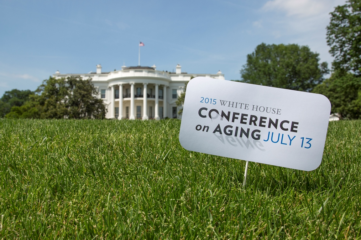 Lawn sign in front of the White House announcing the Conference on Aging July 13