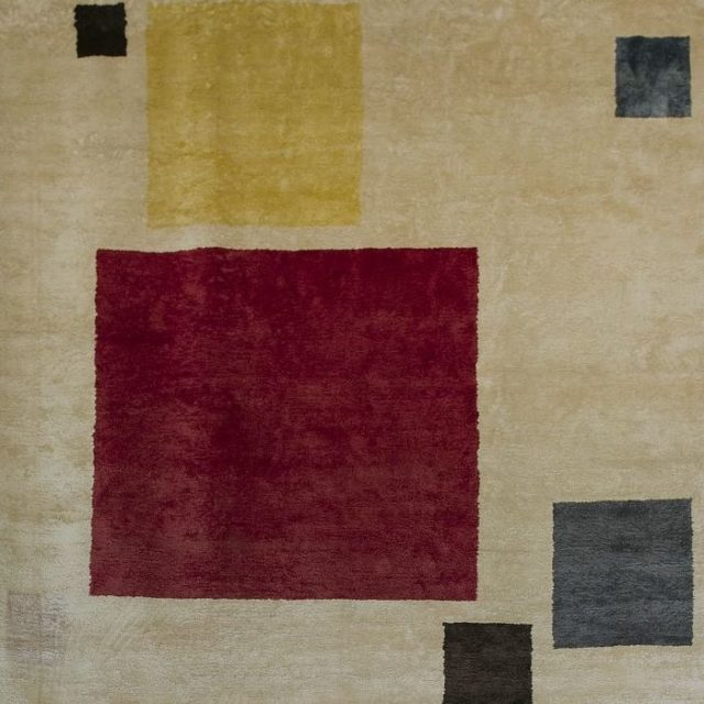 Marcel Breuer's tapestry, Floating. The tapestry's abstract forms are carefully structured: Breuer arranged squares in varying sizes and colors in an overall square field, resulting in a well-balanced composition.