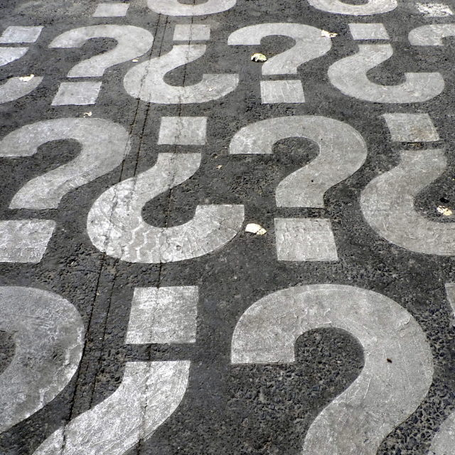 Questions marks painted on pavement