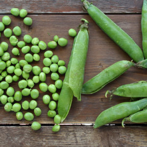 Peas and pods on cutting board