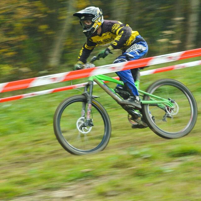 Downhill mountain bike racer in motion
